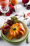 Decorated table with pumpkin and candleholder. Design and concept of a holiday Thanksgiving Day stock photos