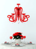 Decorated table and a red lamp Stock Image
