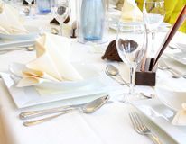 Decorated table in restaurant waiting for guests Royalty Free Stock Photos