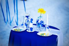 Decorated table. For a romantic dinner in the winter Stock Photography
