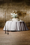 Decorated table. Served with a round table with artificial flowers Stock Images