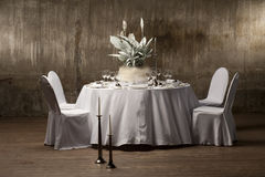 Decorated table. Served with a round table with artificial flowers Royalty Free Stock Photos