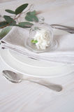 Decorated table setting with linen napkins, white carnation flow Royalty Free Stock Photo