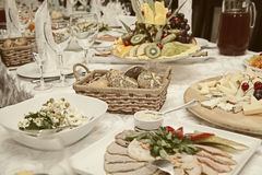 Decorated table with snacks, fruits, salads Royalty Free Stock Photo