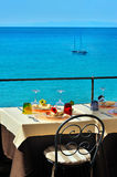 Decorated table on the terrace by the sea Stock Photos