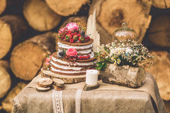 Decorated table for two decorated with floral composition wood background Stock Photos
