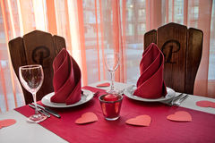 Decorated table for two lovers for a romantic dinner on the day Stock Photos