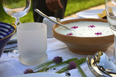Decorated table with tzatziki. A nicely decorated table with glasses and tzatziki sauce Stock Image