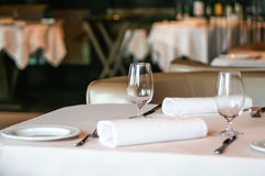 Decorated table. Wine glass, Cutlery and napkin. The Banquet hall. Service. The food is festive Stock Images
