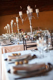 Decorated tables at indoors wedding reception. Selective focus Stock Photos