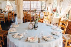 Decorated tables in sky-blue color with silver vase on the centre stock photography