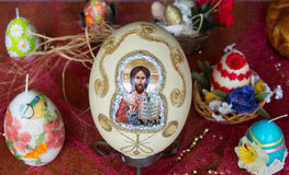 Decorated with textiles and religious motives Easter egg. Royalty Free Stock Image