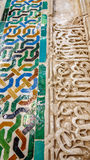 Decorated tiles with geometric shapes in colors, the Alhambra. Detailed closeup view of tiles with geometric shapes in various colors, Alhambra, Andalusia, Spain Stock Image