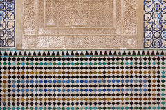 Decorated tiles with geometric shapes in colors in the Alhambra. Detailed view of tiles with geometric shapes in various colors, Alhambra, Andalusia, Spain Royalty Free Stock Image