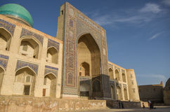 Decorated with traditional ornament facade of Mir-i Arab Madrasa Stock Photos