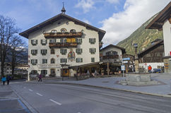 Decorated in the traditional Tyrolean style facade of the hotel. Royalty Free Stock Photo