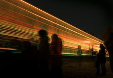 Decorated Train Leaves the Station. While people watch (motion-blur/long-exposure Royalty Free Stock Photography