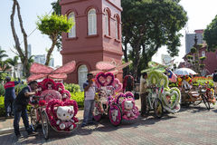 Decorated trishaw with colorful flowers and doll for hire at Malacca city, Malaysia Royalty Free Stock Images