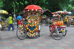 Decorated trishaw in Melaka. Trishaw are commonly used transportation mode in the old days. Today, the trishaws are used as a vehicle for tourist who wants to Stock Photography