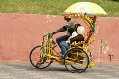 A decorated trishaw or tricycle rickshaw in historical Malacca or Melaka, Malaysia. Many of the heavily decorated cycle rickshaws Malay: beca equipped with sound royalty free stock photo