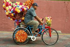A decorated trishaw or tricycle rickshaw in historical Malacca or Melaka, Malaysia. Many of the heavily decorated cycle rickshaws Malay: beca equipped with sound stock images