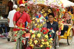 A decorated trishaw or tricycle rickshaw in historical Malacca or Melaka, Malaysia. Many of the heavily decorated cycle rickshaws Malay: beca equipped with sound stock photography