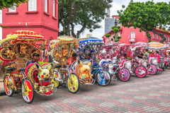 The decorated trishaws are parking in Dutch Square Malacca.Malacca has been listed as a UNESCO World Heritage Site since 7 July 20. Malacca,Malaysia - July 15 Royalty Free Stock Photography