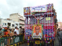 Decorated truck driving on street. Khadia, Ahmedabad, India on 21st June, 2012 - Decorated truck driving on street during the 135th Rathyatra journey into the Royalty Free Stock Photo