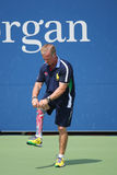 Decorated US Army Veteran Ryan McIntosh with carbon-fiber prosthetic right leg works as US Open ballperson at US Open 2014 Stock Images