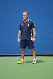 Decorated US Army Veteran Ryan McIntosh with carbon-fiber prosthetic right leg works as US Open ballperson at US Open 2014 Stock Photos