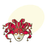 Decorated Venetian carnival, jester mask with bells and golden glitter Royalty Free Stock Photography
