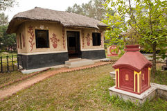 Decorated village hut. A typical decorated tribal clay hut in villages of West Bengal, India Stock Photos
