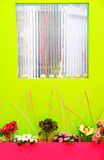 Decorated wall. Green wall with decorative window and flowers Royalty Free Stock Image