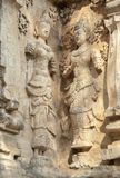 Decorated wall with a mythological figure. In a Buddhist temple Stock Photo