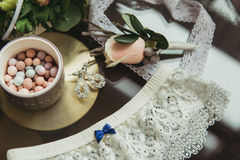 Decorated wedding bouqet near garter and boutonniere Stock Photo