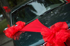 Decorated wedding car. Wedding car decorated with big bright red bows Stock Images