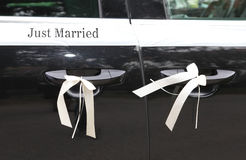 Decorated wedding car with sign Royalty Free Stock Photos
