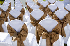 Decorated wedding chairs in a row Stock Photography
