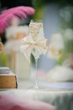 Decorated wedding glass with a ribbon bow Stock Images