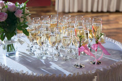 Decorated wedding glasses with champagne Stock Photos