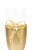 Decorated wedding golden glass wuth bow. Stock Photos