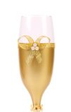 Decorated wedding golden glass wuth bow. Royalty Free Stock Image