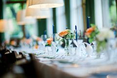 Decorated wedding table in orange, green and blue colors royalty free stock photography