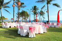 Decorated wedding table at reception beach resort Stock Images