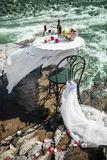 Decorated wedding table on the river Royalty Free Stock Image