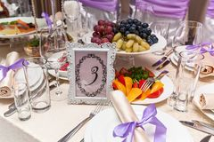 Served wedding table. A decorated wedding table with a seat number five. Served wedding table Stock Photos