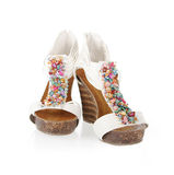 Decorated white wedges shoes Royalty Free Stock Photography