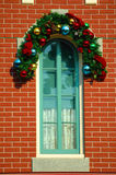 Decorated Window. Window with christmas decoration on the brick wall royalty free stock photo