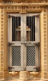 A decorated window in Bikaner. A decorated window forms part of a facade of a building in Jaisalmer, India stock photo