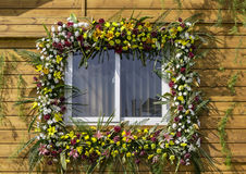 Decorated window with flowers Royalty Free Stock Images
